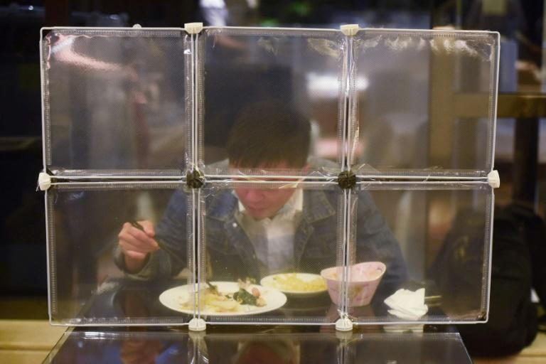 A restaurant in China's eastern Zhejiang province seperates diners with table partitions to prevent coronavirus spread