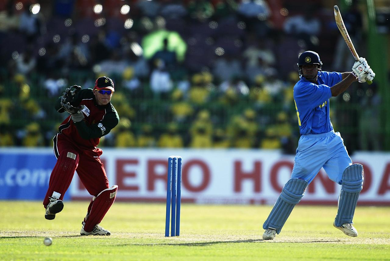 COLOMBO - SEPTEMBER 14:  Mohammad Kaif of India on his way to a century watched by Andy Flower of Zimbabwe during the ICC Champions Trophy match between India and Zimbabwe held on September 14, 2002 at the R. Premadasa Stadium, in Colombo, Sri Lanka. (Photo by Clive Mason/Getty Images)