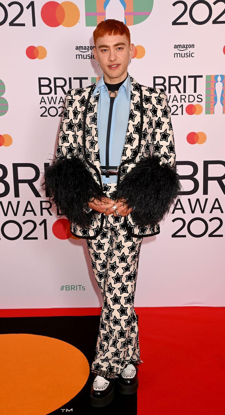 <p><strong>What: </strong>Gucci<strong><br></strong></p><p><strong>Why: </strong>The Years & Years lead singer embraced the feathered trend in a more subdued way with a star-emblazoned suit from Italian luxury house Gucci. Reminiscent of style icon Elton John's statement-making looks, the singer sported a leather harness and mixed-metal rings to bring a certain level of edge.</p>