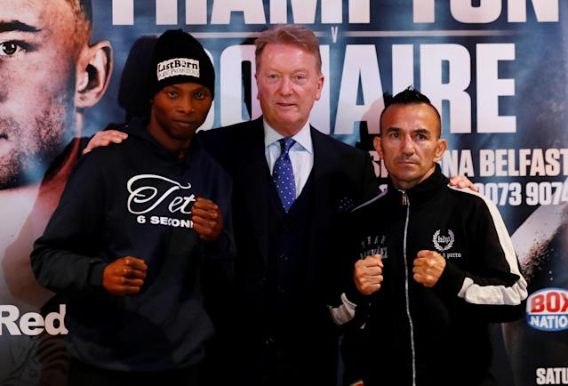 Boxing - Zolani Tete vs Omar Andres Narvaez Press Conference - Victoria Square Shopping Centre, Belfast, Britain - April 18, 2018 Zolani Tete and Omar Andres Narvaez pose with promoter Frank Warren during a press conference Action Images via Reuters/Jason Cairnduff