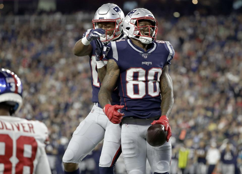 New England Patriots wide receiver Demaryius Thomas (88) celebrates his touchdown catch with Jakobi Meyers, left, in the first half of an NFL preseason football game against the New York Giants, Thursday, Aug. 29, 2019, in Foxborough, Mass. (AP Photo/Steven Senne)