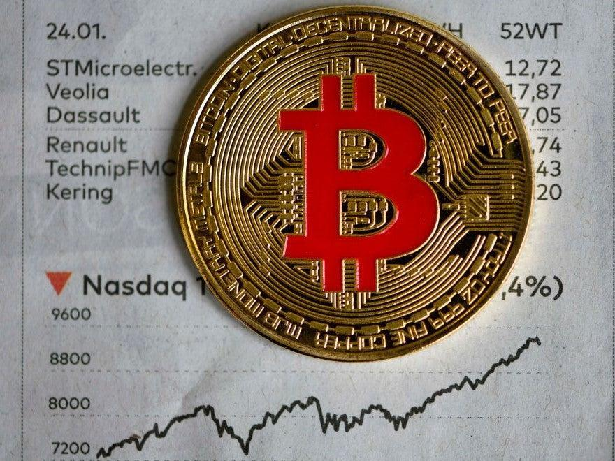 The price of bitcoin hit a new all-time high on 30 November (AFP via Getty Images)