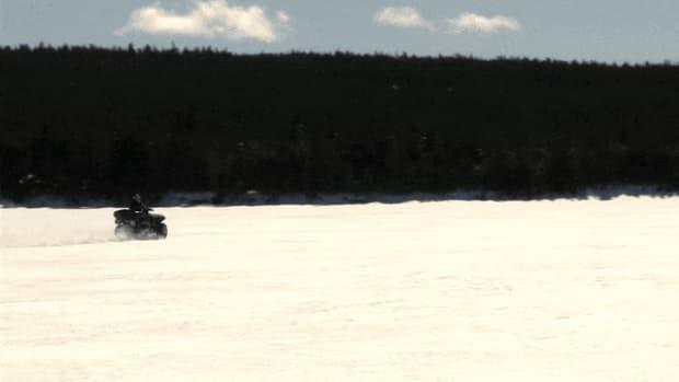 This ATV was seen riding straight across Windsor Lake, a main source of the water supply in the St. John's area.  (Jeremy Eaton/CBC - image credit)