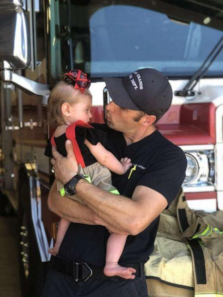 PHOTO: Adam Walker of Gilbert, Arizona, is a firefighter with the Casa Grande Fire Department. Here is is seen in an undated photo with his daughter, Quinn, 2. (Sandee Walker)