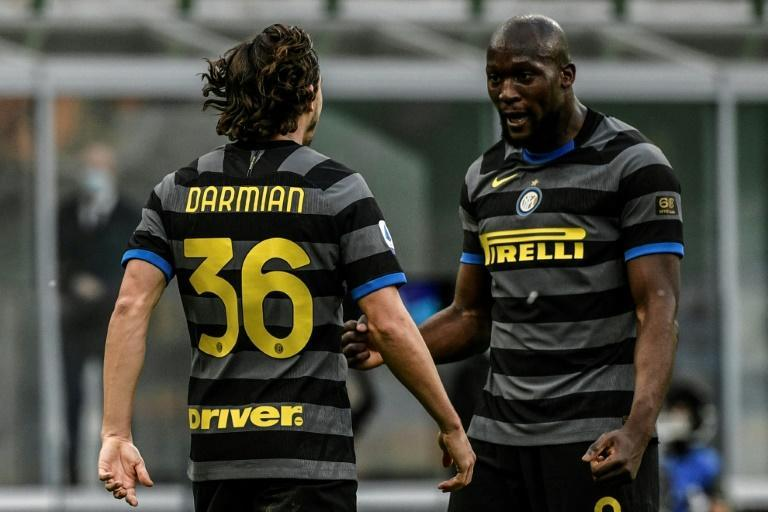 Inter Milan defender Matteo Darmian (L) and forward Romelu Lukaku (R) at the San Siro stadium in Milan.