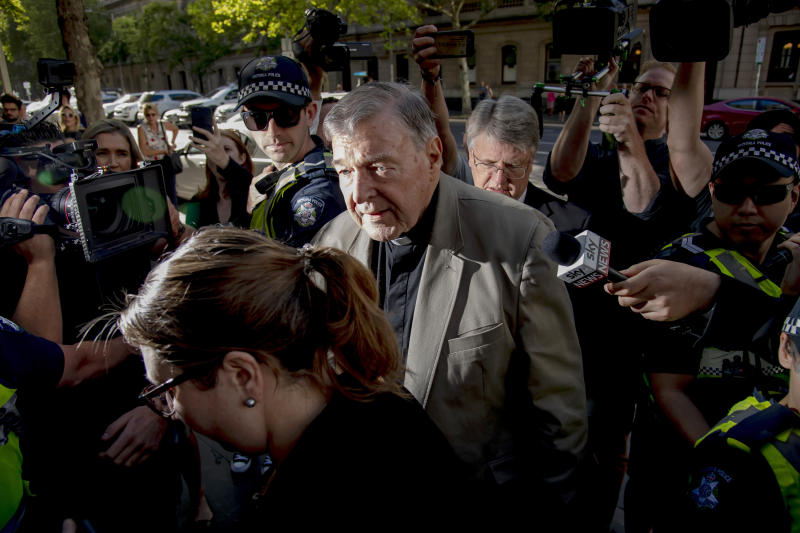 In this Feb. 27, 2019, photo, Cardinal George Pell arrives at the County Court in Melbourne, Australia. The most senior Catholic cleric ever convicted of child sex abuse faces his first night in custody following a sentencing hearing on Wednesday that will decide his punishment for molesting two choirboys in a Melbourne cathedral two decades ago. (AP Photo/Andy Brownbill, File)