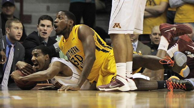 Minnesota's Austin Hollins, left, beats Southern Mississippi's Jeremiah Eason, right, to a loose ball during the second half of an NCAA college basketball game in the third round of the National Invitational Tournament in Minneapolis, Tuesday, March 25, 2014. (AP Photo/Tom Olmscheid)