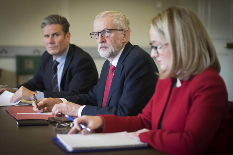Labour leader Jeremy Corbyn, centre, shadow Brexit secretary Keir Starmer, left and shadow business secretary Rebecca Long-Bailey prepare in his office at the Houses of Parliament in London, Wednesday April 3, 2019, ahead of a meeting with Britain's Prime Minister Theresa May for talks on ending the impasse over the country's departure from the European Union — a surprise about-face that left pro-Brexit members of May's Conservative Party howling with outrage. (Stefan Rousseau/PA via AP)