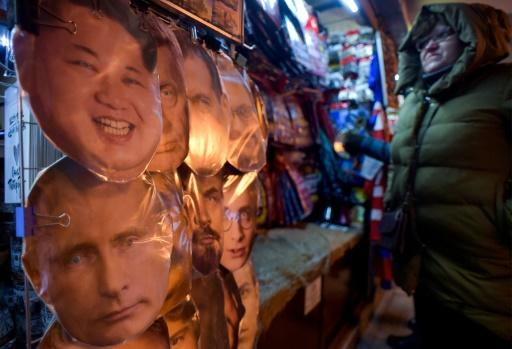 Some have compared the ubiquity of Putin's face with North Korea's personality cult
