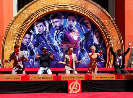 Actors Robert Downey Jr., Chris Evans, Mark Ruffalo, Chris Hemsworth, Scarlett Johansson, Jeremy Renner and Marvel Studios President Kevin Feige place their handprints in cement at a ceremony at the TCL Chinese Theatre in Hollywood