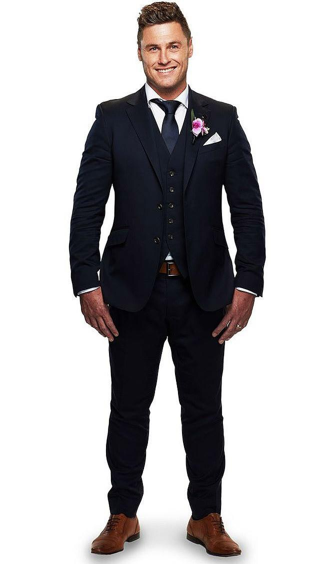 MAFS groom Chris in three piece suit with pink button hole