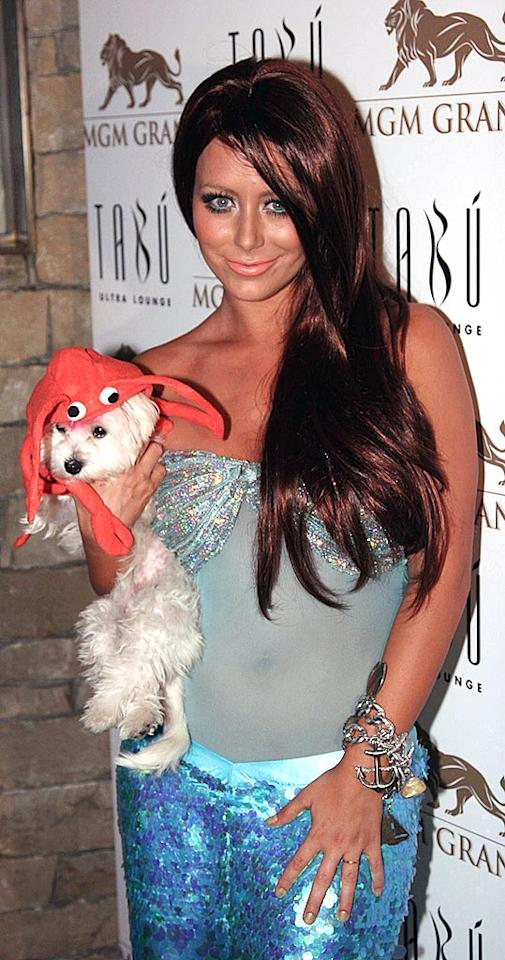 "Despite the fact that Aubrey O'Day's Halloween costume is better than her typical wardrobe malfunctions, we have to chastise her for torturing her pooch with this ghastly getup. MGM Grand/<a href=""http://www.splashnewsonline.com"" target=""new"">Splash News</a> - November 2, 2008"