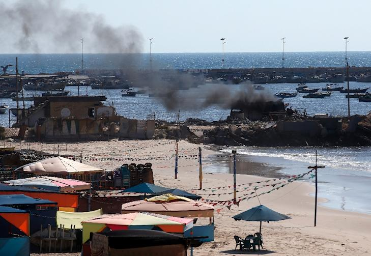 Smoke billows from a beach shack following an Israeli military strike, on July 16, 2014 in Gaza City which killed four children, medics said