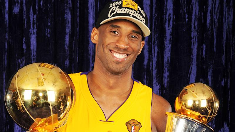 Kobe Bryant, pictured here holding the Larry O'Brien Trophy and the Bill Russell MVP Trophy in 2010.