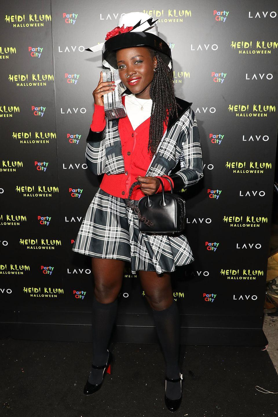 <p>I'm totally buggin' over Lupita's homage to the 1995 classic movie. She's a total betty, thanks to the hat, nose ring, and clunky cell phone. </p>
