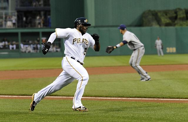 The Pittsburgh Pirates' Josh Harrison (5) scores from second base on a single by Andrew McCutchen during the first inning of a baseball game against the Milwaukee Brewers on Wednesday, Aug. 28, 2013, in Pittsburgh. (AP Photo/Don Wright)