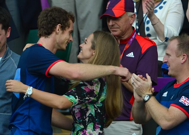 Great Britain's Andy Murray celebrates with his girlfriend Kim Sears after winning the men's singles gold medal match of the London 2012 Olympic Games by defeating Switzerland's Roger Federer, at the All England Tennis Club in Wimbledon, southwest London, on August 5, 2012. AFP PHOTO / MARTIN BERNETTIMARTIN BERNETTI/AFP/GettyImages