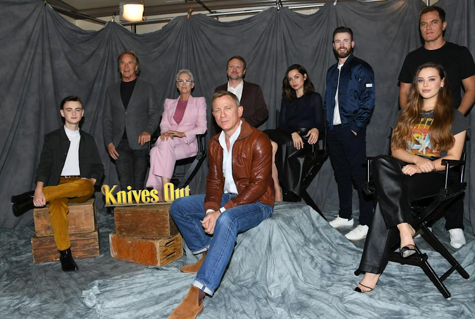 """LOS ANGELES, CALIFORNIA - NOVEMBER 15:  Jaeden Martell, Don Johnson, Jamie Lee Curtis, Rian Johnson, Daniel Craig, Chris Evans, Ana de Armas, Michael Shannon and Katherine Langford attend the photocall for Lionsgate's """"Knives Out"""" at Four Seasons Hotel Los Angeles at Beverly Hills on November 15, 2019 in Los Angeles, California. (Photo by Jon Kopaloff/FilmMagic)"""