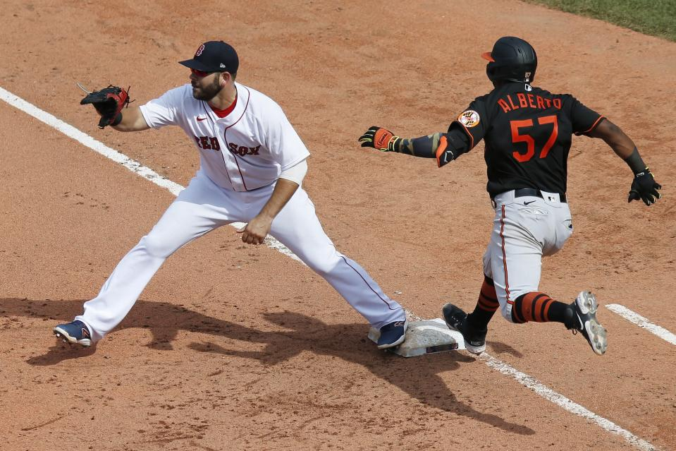 Baltimore Orioles' Hanser Alberto (57) beats the throw to Boston Red Sox's Mitch Moreland at first base after grounding into a force-out during the seventh inning of a baseball game, Saturday, July 25, 2020, in Boston. (AP Photo/Michael Dwyer)