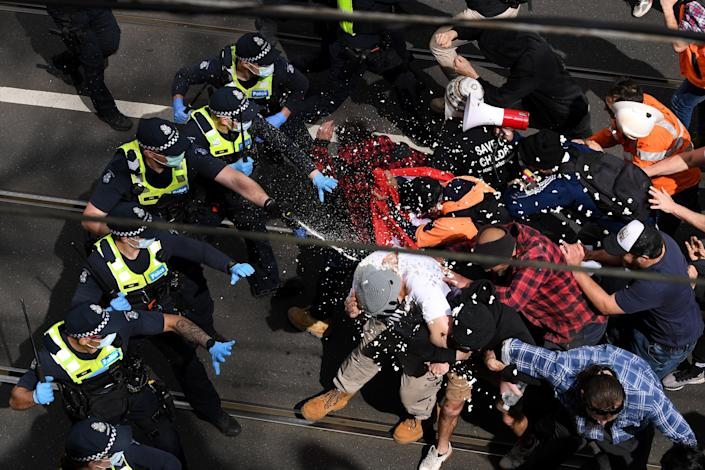Victoria Police clash with protesters during 'The Worldwide Rally for Freedom' in Melbourne (EPA)