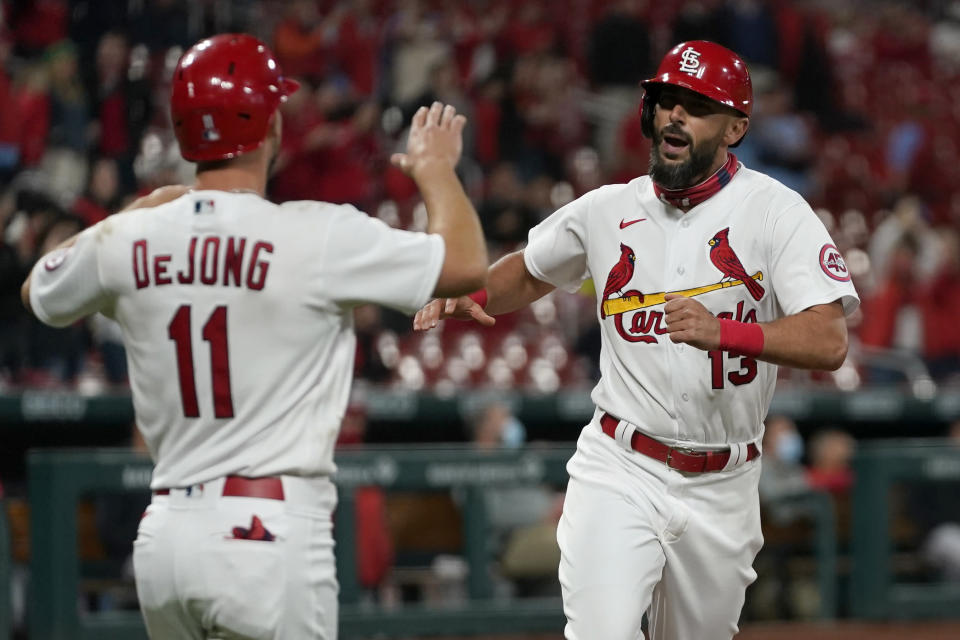 St. Louis Cardinals' Matt Carpenter (13) is congratulated by teammate Paul DeJong (11) after hitting a two-run home run during the third inning of a baseball game against the Washington Nationals Tuesday, April 13, 2021, in St. Louis. (AP Photo/Jeff Roberson)