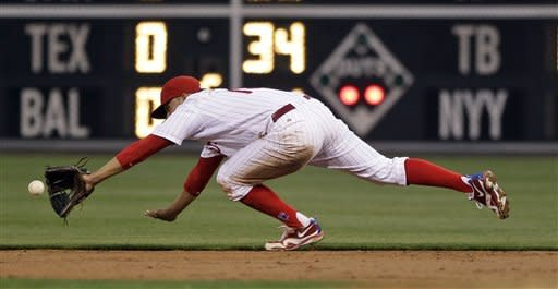 Philadelphia Phillies second baseman Freddy Galvis dives for an infield single by New York Mets' Rob Johnson in the third inning of a baseball game, Wednesday, May 9, 2012, in Philadelphia. (AP Photo/Matt Slocum)