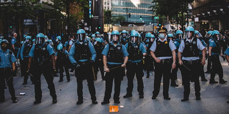 Police force at the Chicago protests for George Floyd , on May 30, 2020 during a protest against the death of George Floyd, an unarmed black man who died while while being arrested and pinned to the ground by the knee of a Minneapolis police officer.