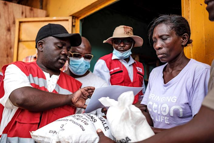 Image: Red Cross volunteers in Uganda (Sumy Sadurni / AFP - Getty Images)