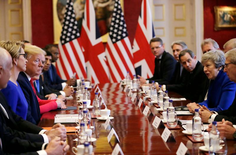 Prime minister Theresa May and US president Donald Trump hold a business breakfast at St James's Palace, London (Picture: PA)