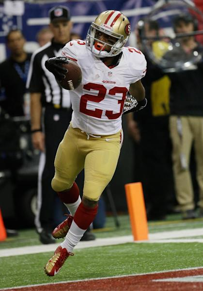 San Francisco 49ers' LaMichael James celebrates after rushing 15-yards for a touchdown during the first half of the NFL football NFC Championship game against the Atlanta Falcons Sunday, Jan. 20, 2013, in Atlanta. (AP Photo/Dave Martin)