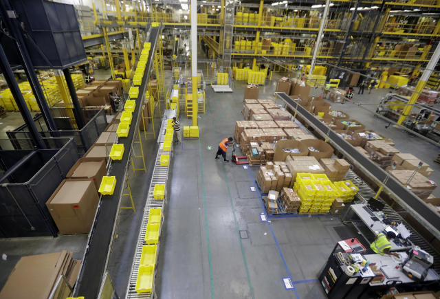In this Tuesday, Aug. 1, 2017, photo, employees work at the Amazon Fulfillment center in Robbinsville Township, N.J. (AP Photo/Julio Cortez)