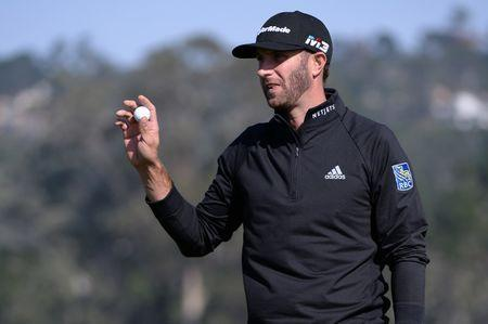 Feb 10, 2018; Pebble Beach, CA, USA; Dustin Johnson acknowledges the crowd after a putt on the sixth green during the third round of the AT&T Pebble Beach Pro-Am golf tournament at Pebble Beach Golf Links. Mandatory Credit: Orlando Ramirez-USA TODAY Sports