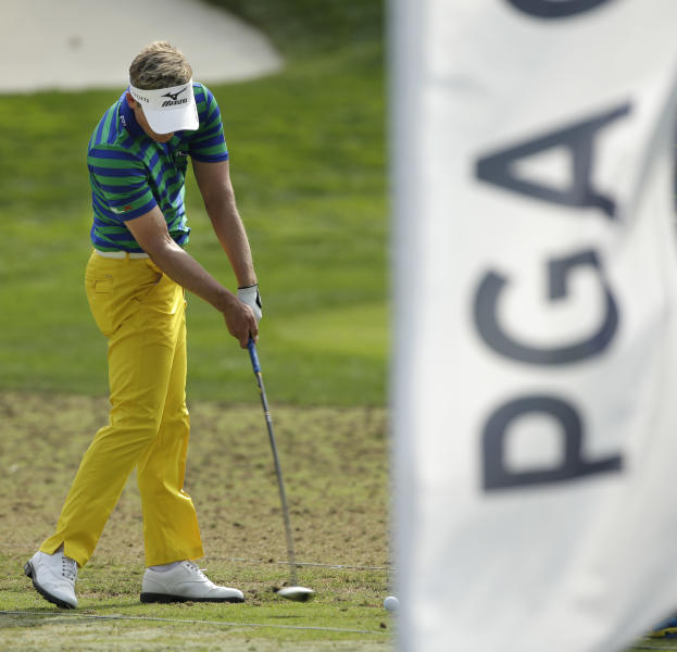 Luke Donald, of England, hit balls on the range after a practice round for the PGA Championship golf tournament at Oak Hill Country Club, Wednesday, Aug. 7, 2013, in Pittsford, N.Y. (AP Photo/Charlie Riedel)