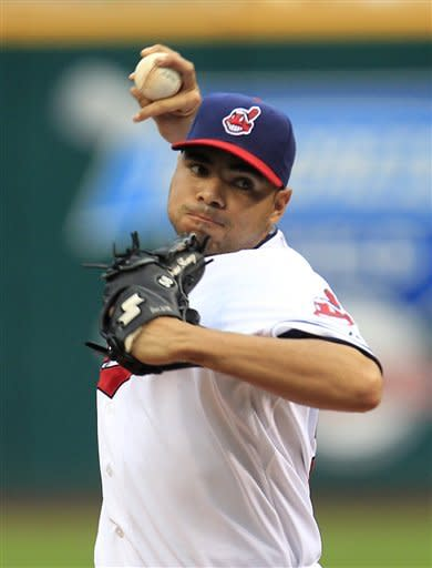 Cleveland Indians starting pitcher Jeanmar Gomez pitches in the first inning in a baseball game against the Texas Rangers, Friday, May 4, 2012, in Cleveland. (AP Photo/Tony Dejak)