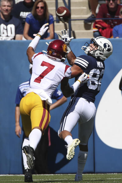 BYU wide receiver Dax Milne (82) catches a touchdown pass over Southern California cornerback Chase Williams (7) in the first half of an NCAA college football game, Saturday, Sept. 14, 2019, in Provo, Utah. (AP Photo/George Frey)