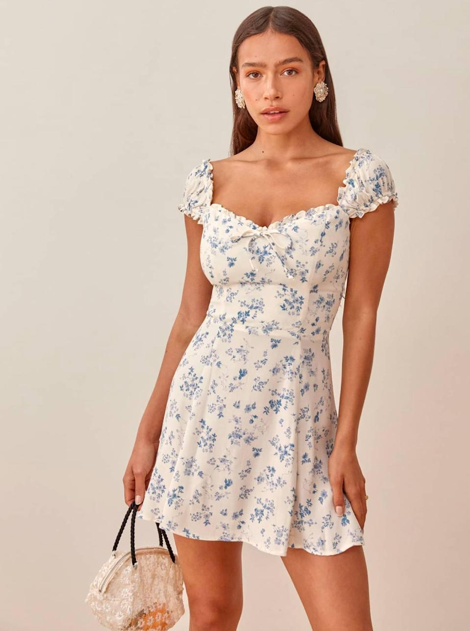 """Is any dress lineup complete without Reformation? The planet-conscious brand nails date-ready styles every single <em>time</em>. $218, Reformation. <a href=""""https://www.thereformation.com/products/pacey-dress?"""" rel=""""nofollow noopener"""" target=""""_blank"""" data-ylk=""""slk:Get it now!"""" class=""""link rapid-noclick-resp"""">Get it now!</a>"""
