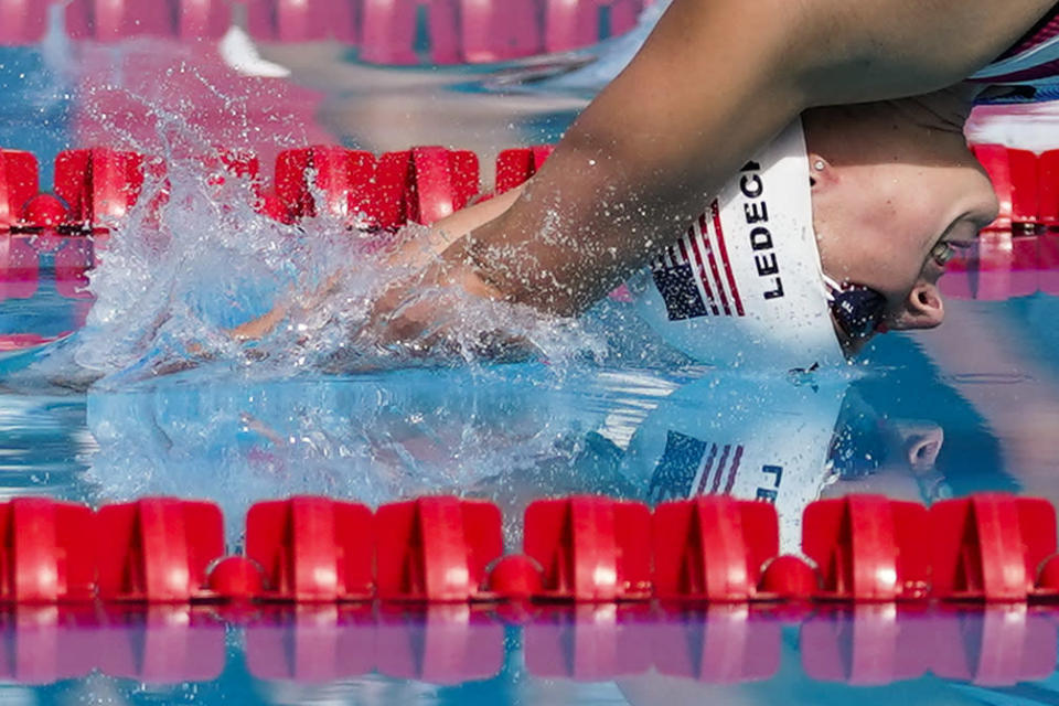 Katie Ledecky dives into the pool at the start of the women's 1500-meter freestyle final at the TYR Pro Swim Series swim meet Sunday, April 11, 2021, in Mission Viejo, Calif. Ledecky finished first. (AP Photo/Ashley Landis)
