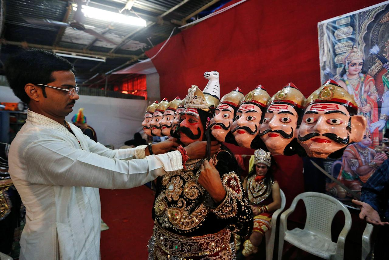 An artist dressed as demon king Ravana gets ready backstage before performing Ramlila, a re-enactment of the life of Hindu Lord Rama, during Vijaya Dashmi or Dussehra festival celebrations in Mumbai, India October 11, 2016. REUTERS/Shailesh Andrade