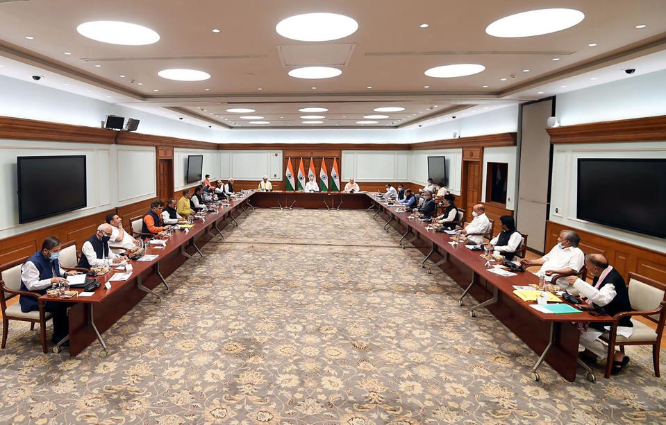 This photograph provided by the Prime Minister's Office shows members of various political parties with Indian Prime Minister Narendra Modi, center, and Home Minister Amit Shah, center right, in New Delhi, India, Thursday, June 24, 2021. India's prime minister is holding a crucial meeting with pro-India politicians from disputed Kashmir on Thursday for the first time since New Delhi stripped the region's semi-autonomy and jailed many of them in a crackdown. (Prime Minister's Office via AP)