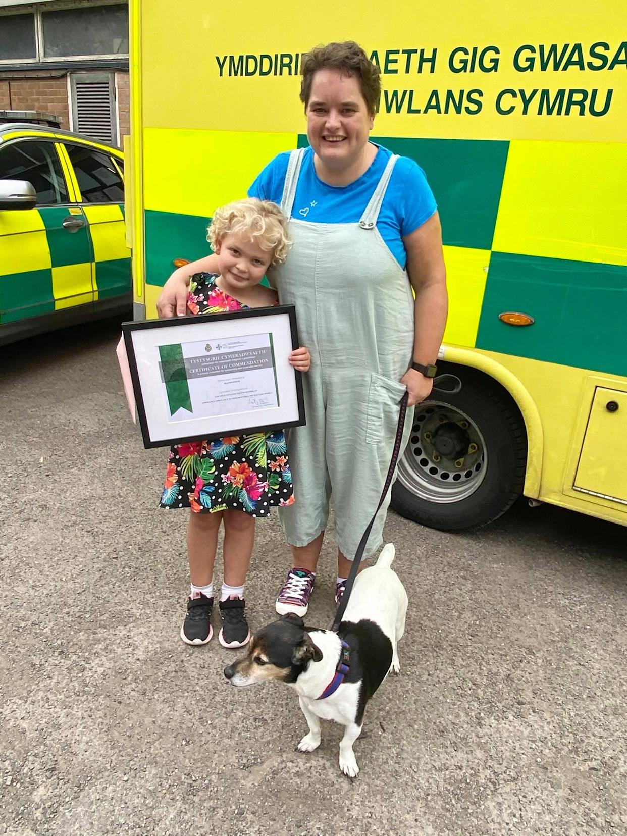 Isla Holifield with her mother Katherine and their dog Roly after being presented with her certificate of commendation (Welsh Ambulance Services NHS Trust/PA)