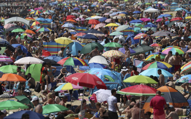 Sun-worshippers defied social distancing and flocked in numbers to seaside hot spots such as Brighton and Bournemouth. (AP)