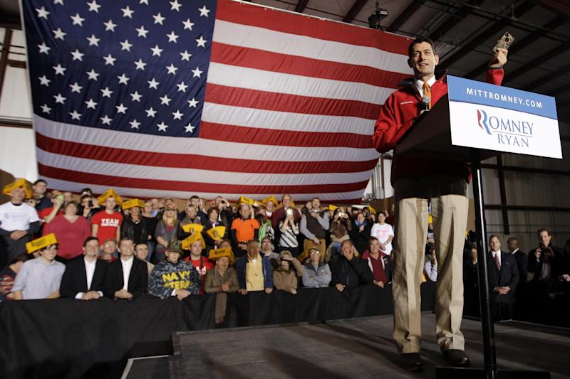 Republican vice presidential candidate, Rep. Paul Ryan, R-Wis., holds up his camouflage covered iPhone while speaking during a campaign event in Green Bay, Wis., Wednesday, Oct. 31, 2012. (AP Photo/Mary Altaffer)