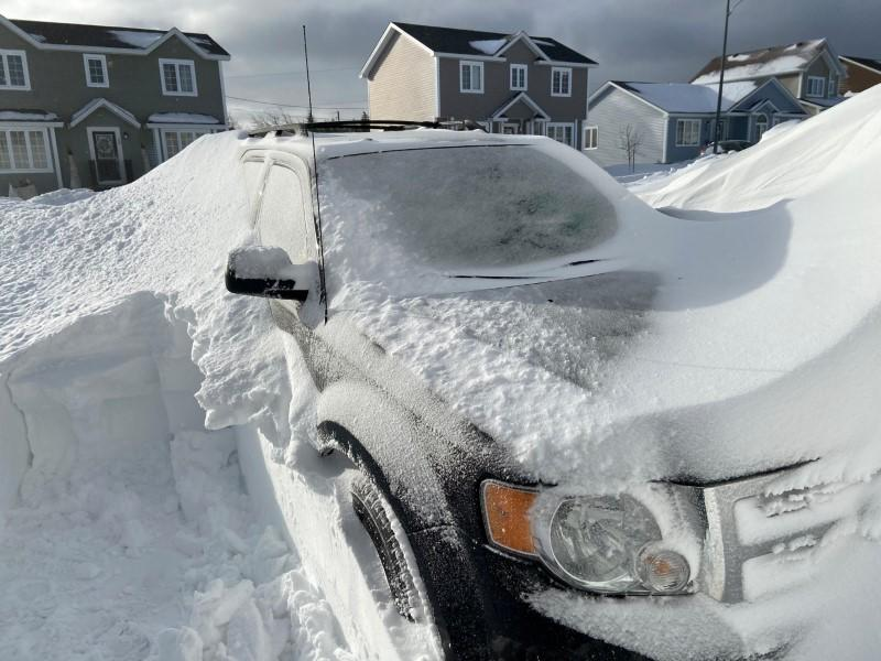 Pile of snow is pictured outside a house in St John's