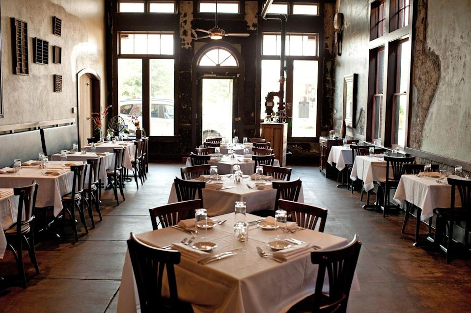 """<p><strong>Tell us about your first impressions when you arrived.</strong><br> Historically, this long, narrow room was a working print shop, and thankfully, the good looks of the original building have been retained. The exposed, polished stone and dark, wooden floors make for a classy atmosphere, the copper-tiled ceiling and unusual light fittings cementing a look that stands out in Lafayette.</p> <p><strong>What was the crowd like?</strong><br> You wouldn't necessarily peg this place as one for hipsters, but younger customers here definitely have a fashion-conscious edge and are looking for high quality ingredients.</p> <p><strong>What should we be drinking?</strong><br> The drinks menu isn't anything fancy, just regular juices and soft drinks, but the coffee stands up to any in the area.</p> <p><strong>Main event: the food. Give us the lowdown—especially what not to miss.</strong><br> <a href=""""https://www.cntraveler.com/gallery/best-brunches-in-new-orleans?mbid=synd_yahoo_rss"""" rel=""""nofollow noopener"""" target=""""_blank"""" data-ylk=""""slk:Breakfast and lunch"""" class=""""link rapid-noclick-resp"""">Breakfast and lunch</a> are the main events here (the restaurant only opens for dinner at the weekend), but the menu is a thoughtful mix of classics and local twists. The Cajun Benedict uses boudin sausages and andouille gumbo, for instance, and the Croque Monsieur was a melty delight of Gruyère and béchamel sauce.</p> <p><strong>And how did the front-of-house folks treat you?</strong><br> It's a busy affair almost from the moment the doors open in a morning, but the staff are unswervingly efficient and polite.</p> <p><strong>What's the real-real on why we're coming here?</strong><br> There's a wealth of casual dining options in Lafayette, but few that even slightly elevate their dining room or ingredients. This café delivers refinement without adding pretension.</p>"""
