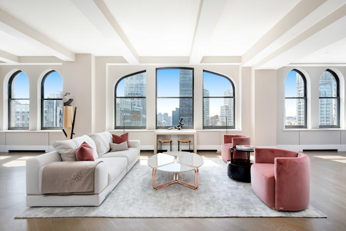 The living room in the penthouse recently purchased by the Amazon CEO.