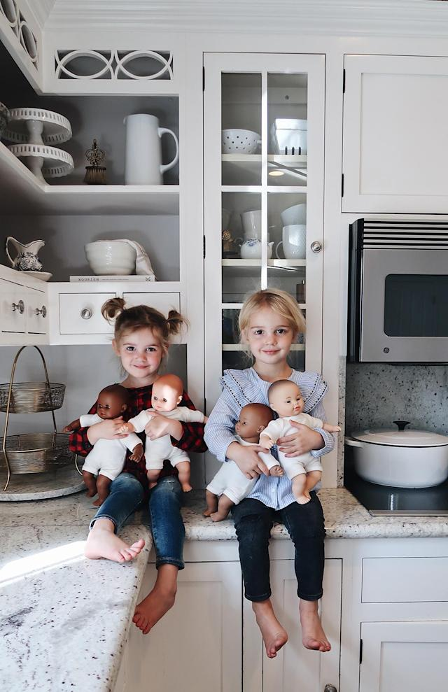 Mila and Emma holding their baby dolls. (Photo courtesy of Katie Stauffer)