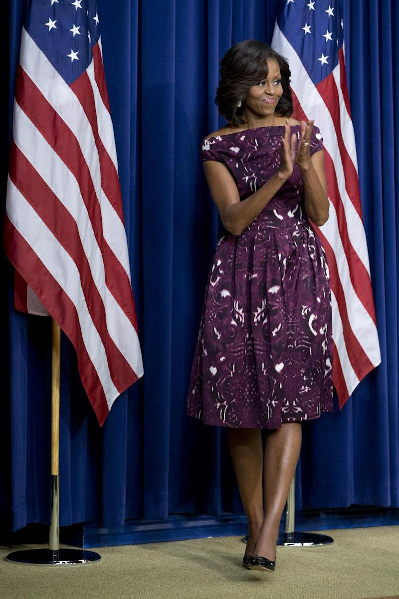 "FILE - This July 10, 2013 file photo shows first lady Michelle Obama applauding after speaking to mayors and other officials about the initiative, ""Let's Move! Cities, Towns and Counties,"" in the Eisenhower Executive Office Building on the White House complex in Washington. Kanye West says when it comes to fashion, Kim Kardashian reigns supreme over every woman, including Michelle Obama. In an interview Tuesday, Oct. 29, with Ryan Seacrest, the rapper said he and his fiancé are ""the most influential with clothing."" Despite West's words, the first lady is a fashion trendsetter and clothes she's worn have sold out quickly after she's worn them in public. (AP Photo/Jacquelyn Martin, File)"