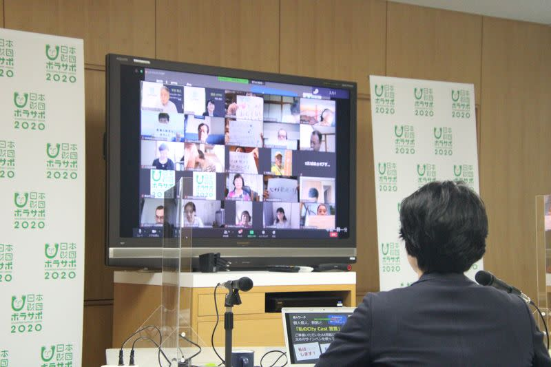 A screen displays an online gathering with volunteers for the 2020 Olympics in Tokyo