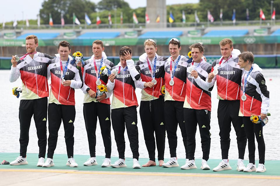 TOKYO, JAPAN - JULY 30:  Silver medalists Johannes Weissenfeld, Laurits Follert, Olaf Roggensack, Torben Johannesen, Jakob Schneider, Malte Jakschik, Richard Schmidt, Hannes Ocik and Martin Sauer of Team Germany pose with their medals during the medal ceremony for the Men's Eight Final A on day seven of the Tokyo 2020 Olympic Games at Sea Forest Waterway on July 30, 2021 in Tokyo, Japan. (Photo by Leon Neal/Getty Images)