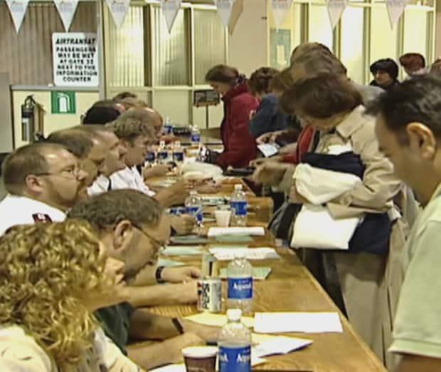 When thousands of stranded passengers arrived in Gander during 9/11, volunteers were ready to coordinate a large-scale emergency response. Alison Boland of Stephenville helped to serve 1,000 meals to people getting off the planes eight planes grounded there. (CBC - image credit)